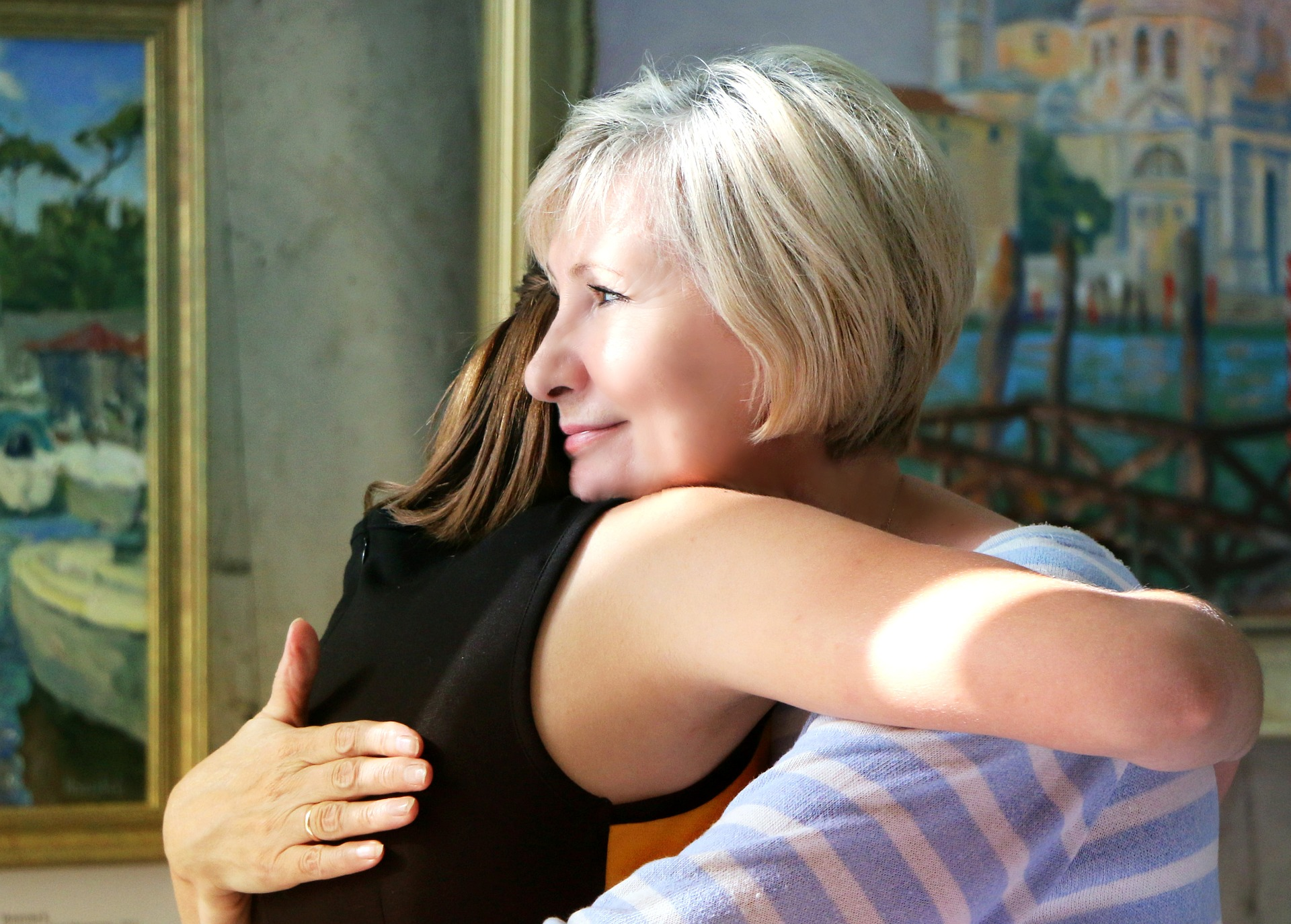 Picture of two women hugging each other